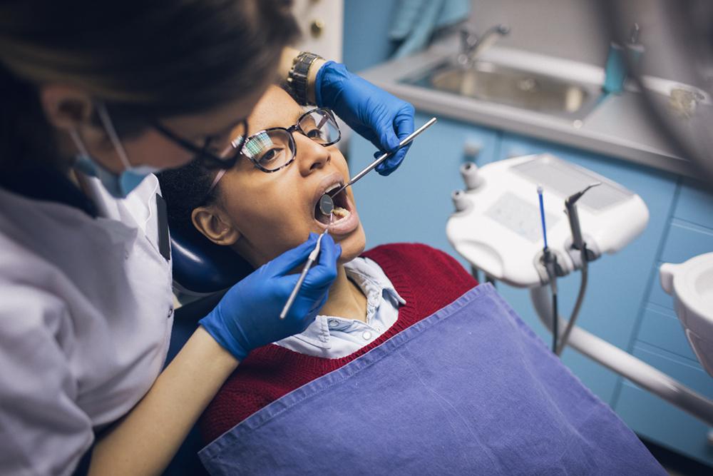Young woman at dental check-up.